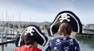 two boys over looking the water with pirate hats on for Portola Pirate Program