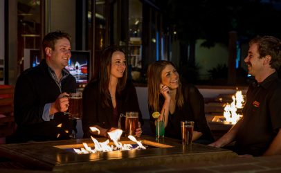 sit around the firepit at Peter B's Brewpub