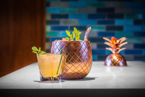 golden pineapple cocktail container and cocktail served at Jacks Monterey