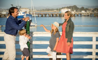 leisure photo of family taking photo outdoors in Monterey CA